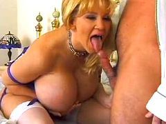 Milf with amazing huge breast going naughty in bed