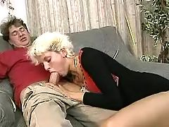 Short haired milf slobbers big cock