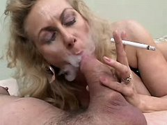 Smoking mature gets cumshot on tits