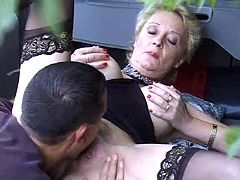 Old whore having fun with young hunk in fresh air